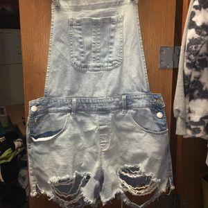 Distressed light blue overalls